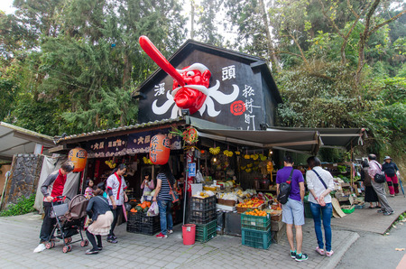 Xitou Taiwan  March 21 2015 : Xitou Monster Village is a Japanese style village in Xitouthere are different type of restaurants and souvenirs shop around it.People can seen exploring around it.