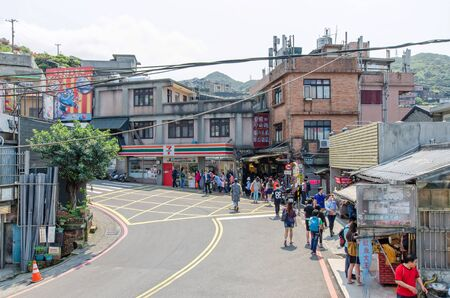 jiufen: JiufenTaiwan  March 18 2015: Tourists can seen walking through the entrance of Jiufen old street along the street there are shops vending the most famous country snack and various local accessories.