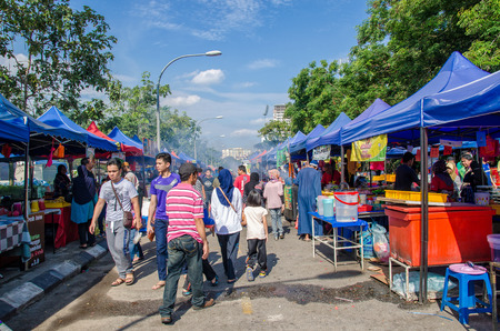 break fast: Kuala Lumpur,Malaysia - July 5, 2015: People seen walking and buying foods around the Ramadan Bazaar.It is established for muslim to break fast during the holy month of Ramadan.