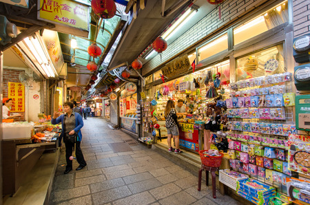 jiufen: Jiufen,Taiwan - March 18,2015 : Tourists can seen walking through the Jiufen old street,along the street there are shops vending the most famous country snack of Jiufen, and various local accessories.