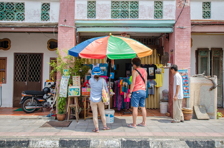 georgetown: Georgetown,Penang - July 17,2015 : People can seen buying and exploring in front of souvenir stall in the street art in Georgetown, Penang