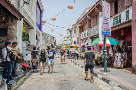 georgetown: Georgetown,Penang - July 17,2015 : People can seen walking and exploring around the street art in Georgetown, Penang