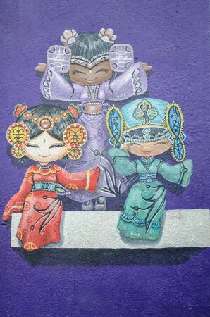 georgetown: Georgetown,Penang - July 17,2015 : Three Chinese dolls painting on the street wall at the street art in Georgetown, Penang