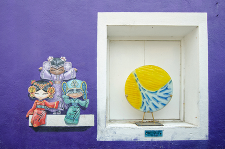 georgetown: Georgetown,Penang - July 17,2015 : Three Chinese dolls painting and Shoal of fish artwork at the street art in Georgetown, Penang Editorial