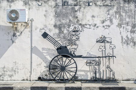 street rod: Georgetown,Penang - July 18,2015 : Wire steel rod wire art by local artist which is located at Cannon street in Georgetown, Penang