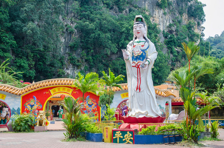 ling: Ipoh,Malaysia - July 16,2015 : Guan Yin statue which is located at Ling Sen Tong Cave Temple, the temple located at the Gurung Rapat area and it is just beside to the main road Jalan Gopeng.