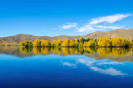 reflect: Autumn reflections at Wairepo Arm, Lake Ruataniwha in New Zealand. Stock Photo