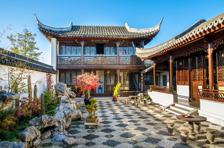 tower block: Dunedin,New Zealand - May 3,2016 : Tower block or conference room in The Dunedin Chinese Garden,this two-storey building is traditionally a place for a quiet drink with peaceful music.