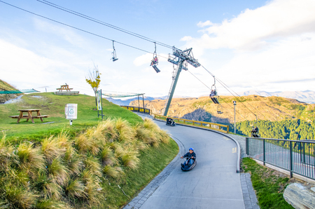 luge: Queenstown,New Zealand - April 25,2016 : People can seen playing luge car in Queenstown Skyline,New Zealand. Editorial