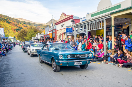 Arrowtown, New Zealand - April 23,2016 : There is parade event during the Arrowtown Autumn Festival on Buckingham Street, people can seen watching and enjoying the parade. Editorial