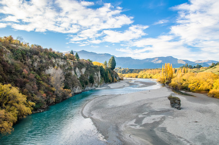 Beautiful view from the Historic Bridge over Shotover River in Arrowtown, New Zealand. Stock Photo