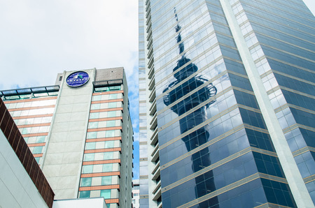 neighbour: Auckland,New Zealand - September 18,2015 : SKYCITY Auckland Casino and Sky Tower reflected on the neighbour building in Auckland, New Zealand