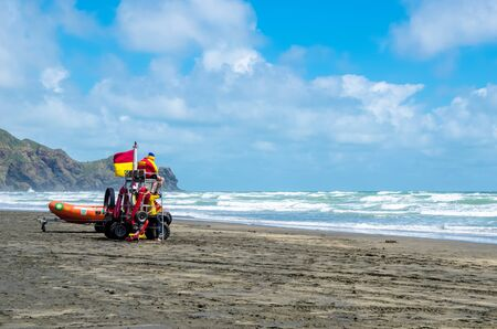 te: Auckland,New Zealand - December 19,2015 : Lifeguard can seen standby on the beach to supervises the safety and rescue of swimmers and surfers in the Te Henga (Bethells Beach). Editorial