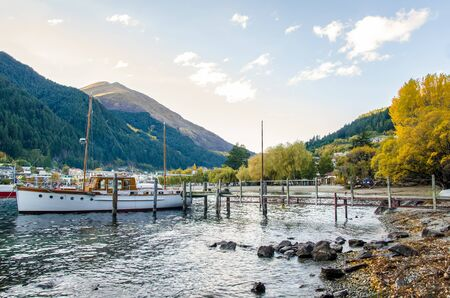 Boats parking at the jetty of Lake Wakatipu in Queenstown, New Zealand.