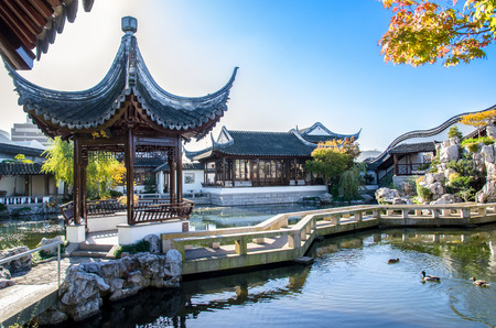 chinese garden: Dunedin,New Zealand - May 3,2016 : Zigzag bridge is one of the important elements of The Dunedin Chinese Garden design.It can connecting the Heart of the Lake Pavilion and the rock mountain. Editorial