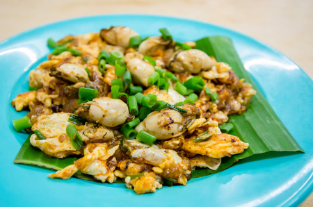 Fried oyster omelette is a popular food in Malaysia and Singapore.