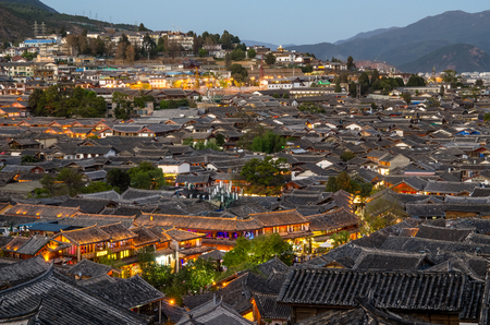 Lijiang, China - April 10,2017 : Evening bird eye view of local historical architecture roof building of Old Town of Lijiang in Yunnan, China.