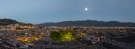 Evening bird eye view of local historical architecture roof building of Old Town of Lijiang in Yunnan, China.