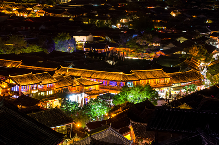 Bird eye view of local historical architecture roof building of Old Town of Lijiang in Yunnan, China. 新闻类图片