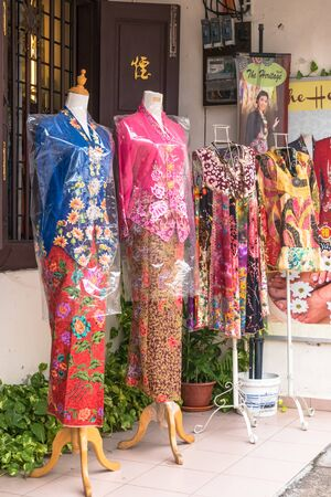 clothing store: Malacca,Malaysia - July 15,2017 : There are some different style of nyonya costumes selling at Jonker Street,Malacca.