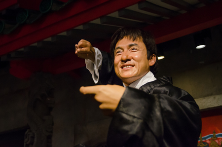 Singapore - September 15,2015 : The wax figure of Jackie Chan in Madame Tussauds Singapore. Jackie Chan is a Hong Kong actor,artist, singer and film director