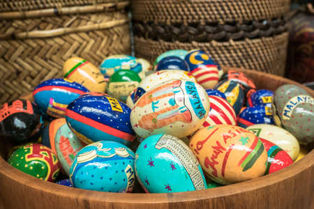 Colorful Easter eggs in the wooden bucket. It is decorated eggs that are usually used as gifts on the occasion of Easter or springtime celebration.