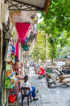 Hanoi,Vietnam - November 2,2017 : Street view of the Hanoi Old Quarter, women can seen chit chatting outside the store. Editorial