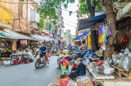 Hanoi,Vietnam - October 31,2017 : Busy local daily life of the morning street market in Hanoi, Vietnam. People can seen exploring around the market.
