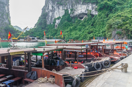 Halong Bay,Vietnam - November 4,2017 : Boats can seen parking at the harbor in  Surprise Cave (Sung Sot Cave),Vietnam.