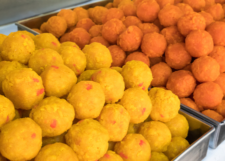 Famous Indian snack called Motichoor Ladoo, it also knows as laddoo, laddo or laddu. It is a sweet ball shaped and a favourite festive treat across India. Stock Photo