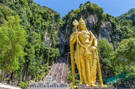 Kuala Lumpur, Malaysia - February 13 , 2018: Batu Caves is a limestone hill that has a series of caves and cave temples in Gombak,Malaysia. People can seen exploring around it.