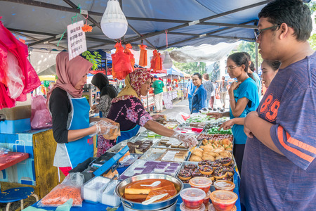 Kuala Lumpur,Malaysia - May 27, 2018 : People can seen buying foods and snacks at the stall in Ramadan Bazaar.It is established for muslim to break fast during the holy month of Ramadan.