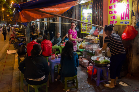 Hanoi,Vietname - November 5,2017 - People can seen enjoying their food at the food stalls in Hanoi,Vietnam.