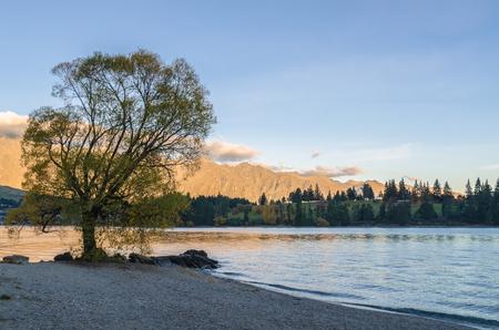 Beautiful sunset view in the Lake Wakatipu Queenstown, New Zealand. Stock Photo