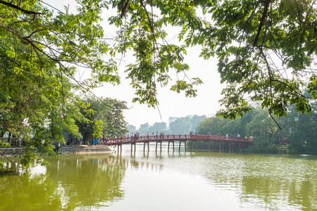 Hanoi,Vietnam - November 2,2017 : Red Huc bridge in Hoan Kiem Lake,Hanoi. Hoan Kiem Lake meaning