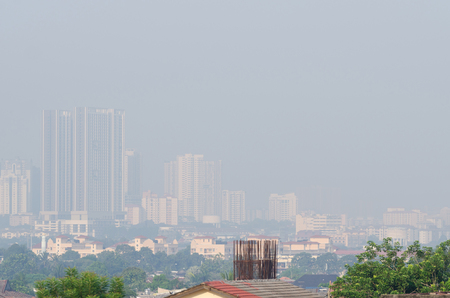 Low visibility city view with dangerous haze and fog in Kuala Lumpur,Malaysia. Stock Photo
