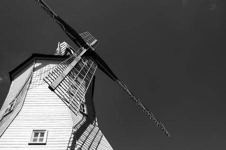 Looking upwards to the windmill building in black and white. Stock Photo