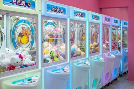 Kuala Lumpur,Malaysia - September 7,2019 : Colorful arcade game toy claw crane machine where people can win toys and other prizes which is located in the shopping mall,Kuala Lumpur.
