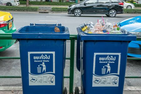 Bangkok,Thailand - November 2,2019 : Blue trash bin full of garbage plastic waste trash. Trash plastic pollution.