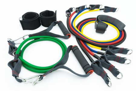 A set of colorful resistance bands,door anchor and foot ring isolated on the white background.