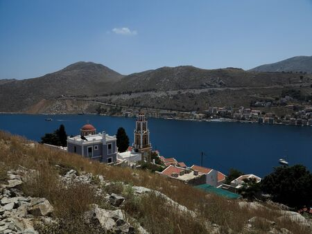 Tourism - View of the bay of mediterranian island. View of church.