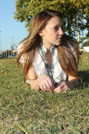 Beautiful woman in the park grass