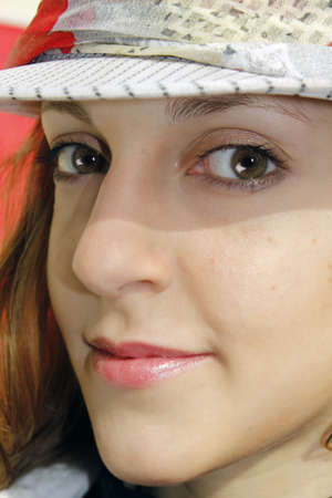 Beautiful girl with hat and cheeky look  Stock Photo - 9729947