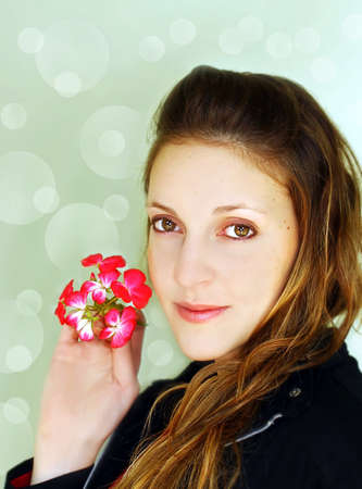 Woman posing with a magenta flower Stock Photo - 11673509