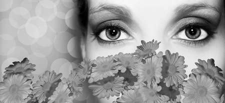 Woman behind the flowers with eye makeup. White and black Stock Photo - 11673510