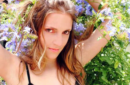 Beautiful woman in blue flowers Stock Photo - 11673521