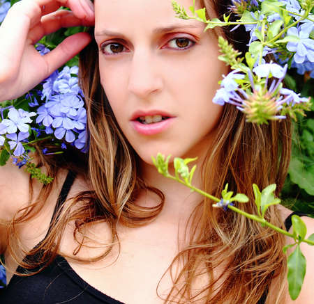 Woman in nature among flowers , making gesture Stock Photo - 11789800
