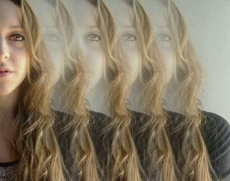 Beautiful woman is reflected on itself