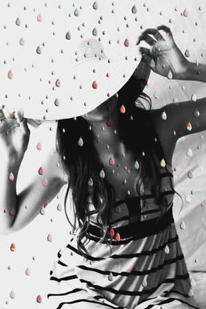 Woman under shower of colored drops