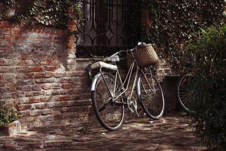 Vintage style bike with a wicker basket photo